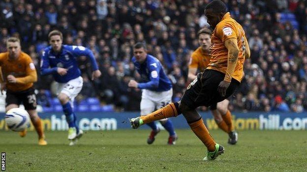 Sylvan Ebanks-Blake tucks away Wolves' third goal at St Andrew's on Monday from the penalty spot