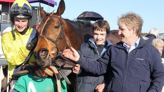 Pineau De Re rode by Danny Mullins after the race with trainer Philip Fenton (right)