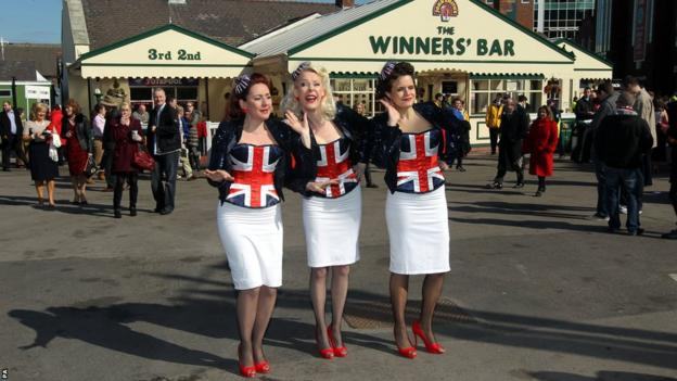 Singers entertain the crowd at Aintree