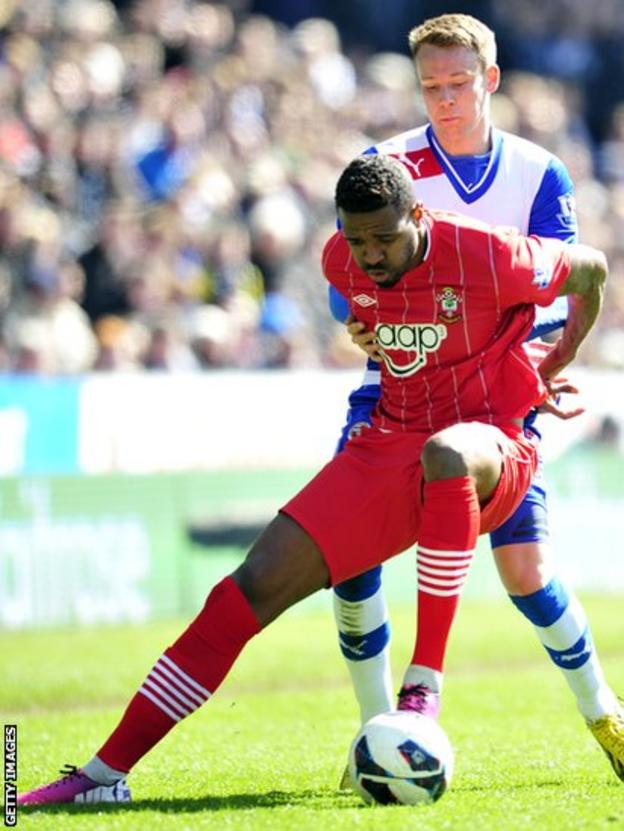 Southampton's Brazilian midfielder Guly Do Prado (front) vies with Reading's Welsh defender Chris Gunter (back) in the Premier League