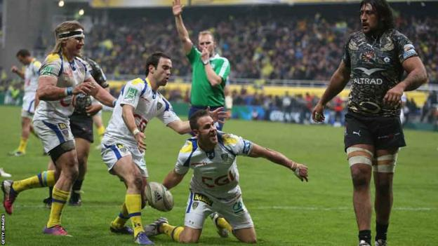 Lee Byrne celebrates one of five Clermont Auvergne tries as they beat Montpellier 36-14 to reach the Heineken Cup semi-finals