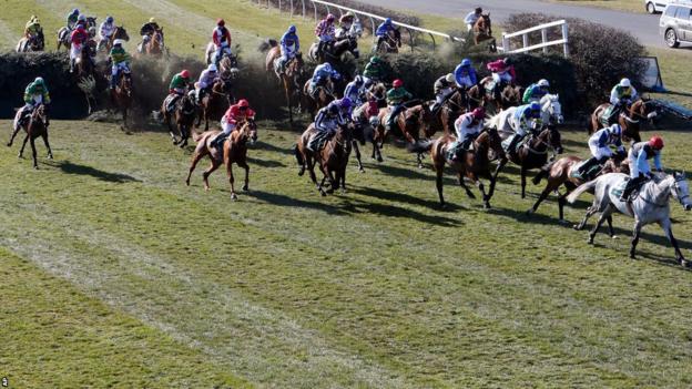 Horses jump Becher's Brook