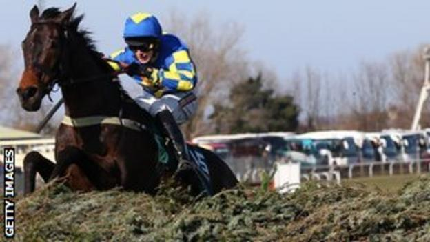 Auroras Encore glides over the new fences at the Grand National