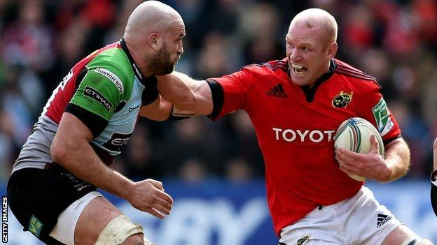 Harlequins second row George Robson looks to tackle Munster counterpart Paul O'Connell
