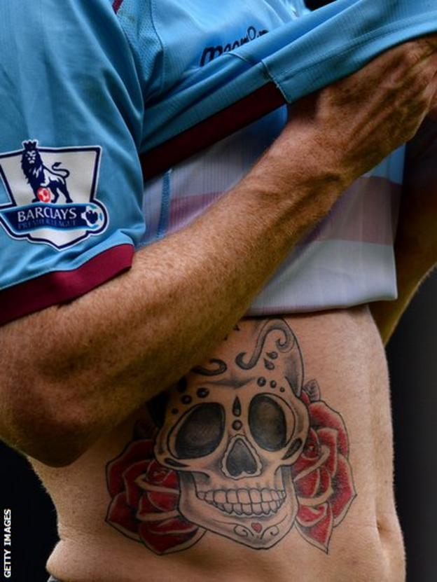 West Ham United's Welsh defender James Collins displays his tattoo during their 0-0 Premier League draw at Liverpool
