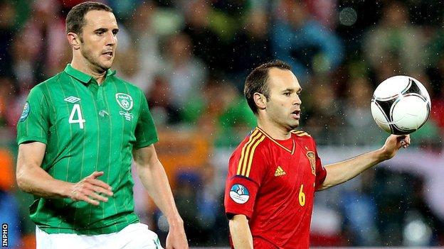 John O'Shea battles with Andres Iniesta during last year's game at Euro 2012