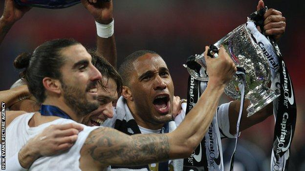 Swansea City celebrate winning the Capital One Cup