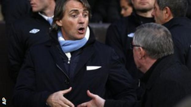 Manchester City boss Roberto Mancini shakes hands with Manchester United manager Sir Alex Ferguson