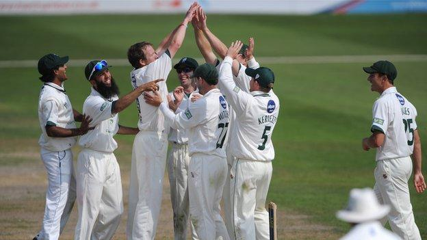 Alan Richardson celebrates one of his eight wickets against Lancashire at New Road, September 2011