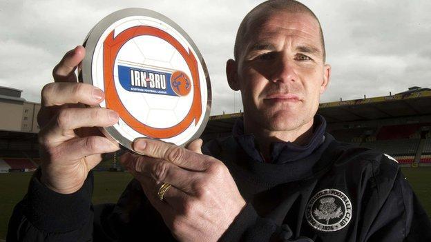 Alan Archibald with his award