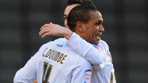 Mathias Doumbe celebrates scoring for MK Dons