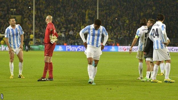 Malaga players after their defeat