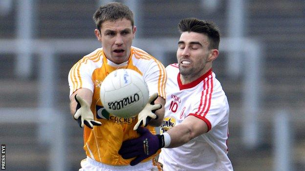 Tony Scullion in action for Antrim in the McKenna Cup against Tyrone earlier this season