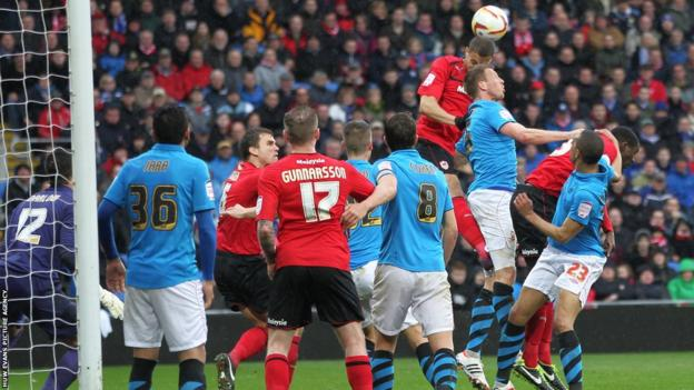 Substitute Rudy Gestede heads home Cardiff's third goal against Nottingham Forest to put Malky Mackay's side on the brink of promotion to the Premier League.