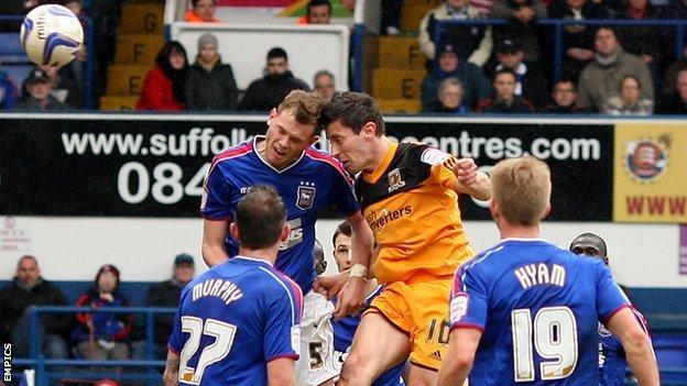 Hull midfielder Robert Koren heads in his side's winner against Ipswich