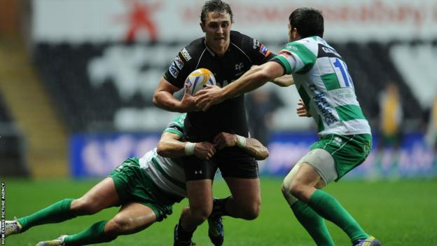 Ospreys centre Ashley Beck is tackled by Treviso duo Tobie Botes and Edoardo Gori during the Pro12 clash at the Liberty Stadium.