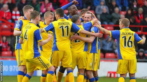 Kidderminster Harriers players celebrate James Vincent's opening goal at the Racecourse Ground