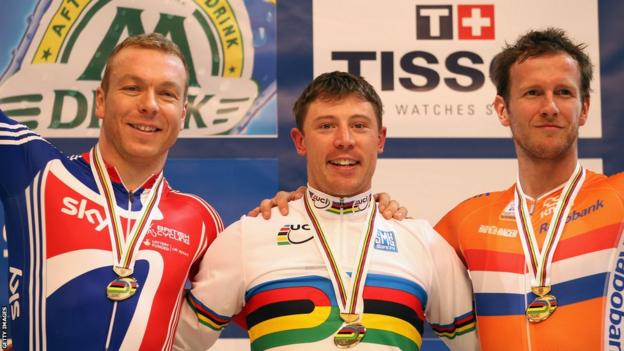 Chris Hoy (left) celebrates winning silver on the podium with Shane Perkins (centre) and Tuen Mulder after the keirin final during the World Championships in Apeldoorn, Netherlands