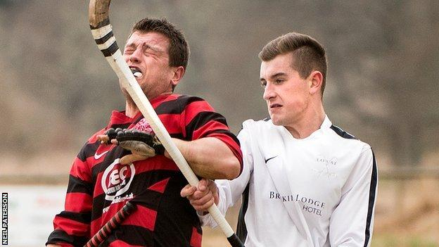 Oban's Ian Campbell winces in a challenge with Lovat's Lewis Tawse