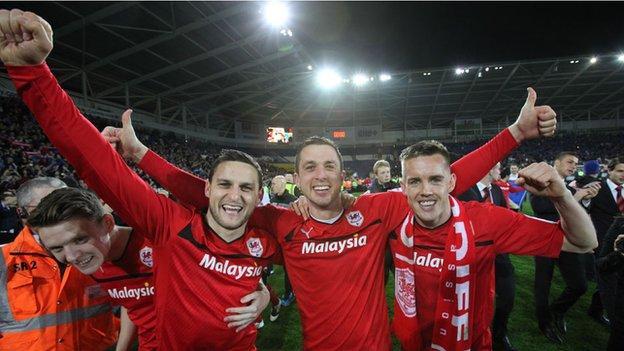 Cardiff players celebrate winning promotion
