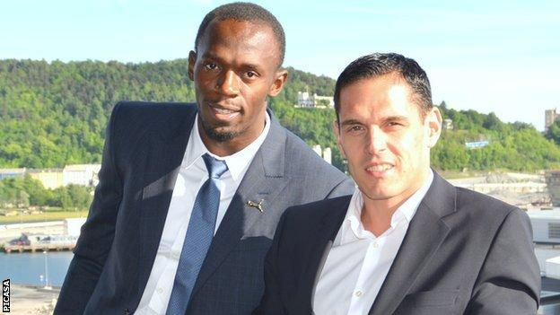 Usain Bolt and Ricky Simms (right)