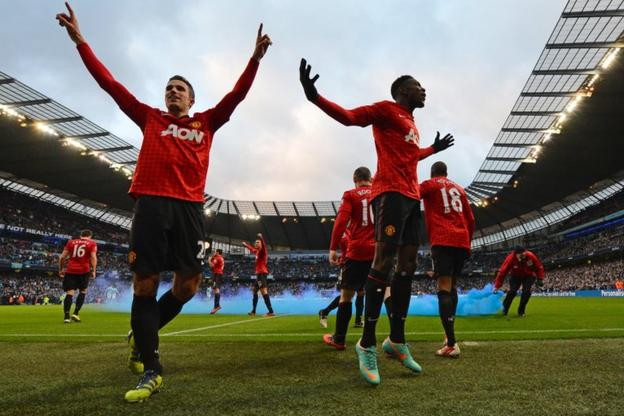 Robin van Persie (left) celebrates his winner at Manchester City