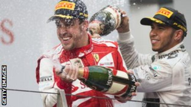 Fernando Alonso (left) with Lewis Hamilton