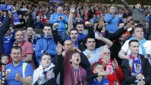 Cardiff City supporters celebrate winning the Championship title