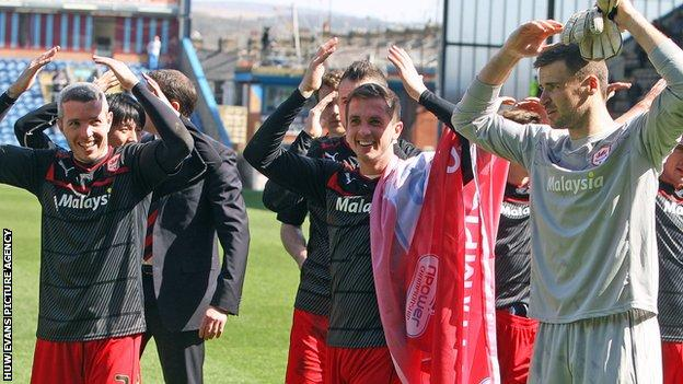 Andrew Taylor (centre) celebrates with Kevin McNaughton and David Marshall