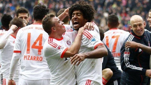 Bayern Munich celebrate winning the Bundesliga title