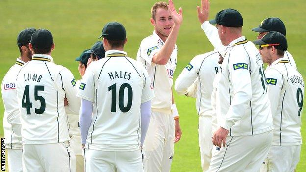 Nottinghamshire players celebrate with Stuart Broad