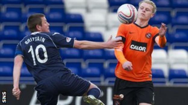 County captain Richard Brittain tries to contain United's Gary Mackay-Steven