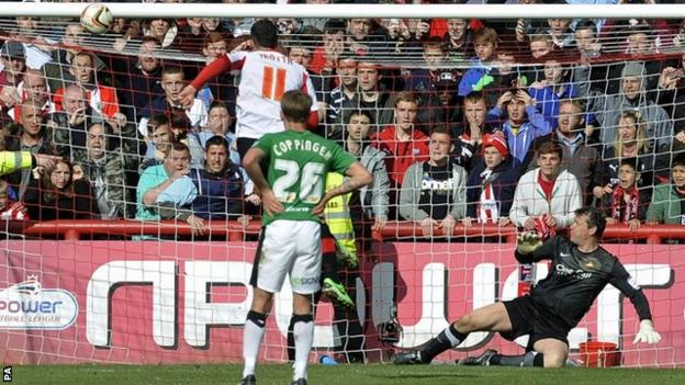 Marcello Trotta's penalty comes off the bar