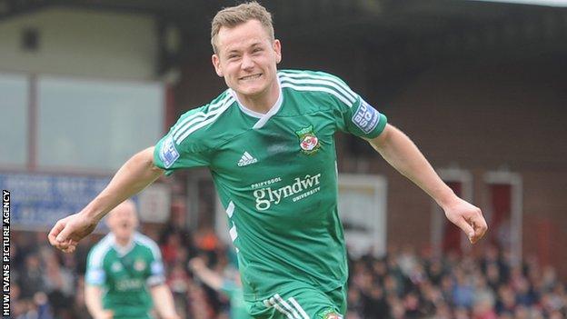 Joe Clarke celebrates Wrexham's second goal against Kidderminster
