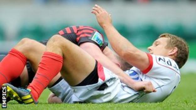 Jonny Wilkinson pats a despondent Owen Farrell on the back after the Saracens fly-half failed to charge down his opposite number's drop-kick