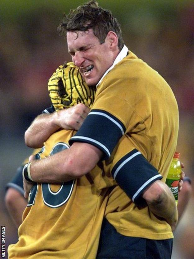 Justin Harrison (right) embraces Elton Flatley after Australia's win in Sydney