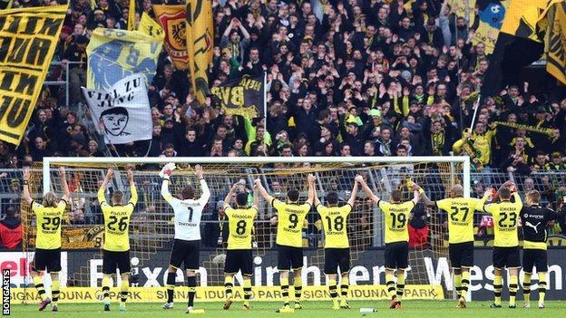 Borussia Dortmund players and fans celebrate