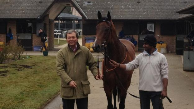Trainer William Haggas with one-time 1000 Guineas hopeful Rosdhu Queen and her groom, who shares the same name as Indian cricketer Mohammed Azharuddin. The filly is set to run at Royal Ascot in June