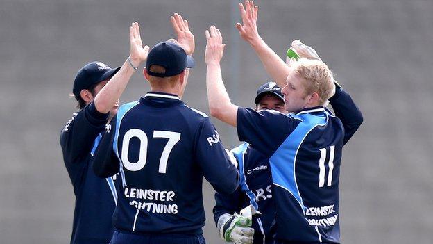 Eddie Richardson celebrates after taking a wicket