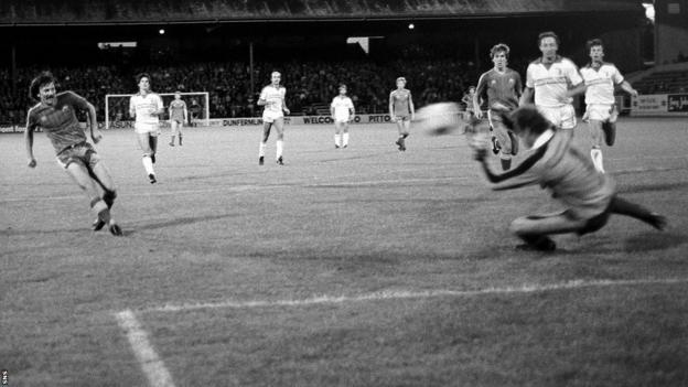 Stuart Kennedy (left) rounds off the scoring as Aberdeen open the tournament with a 7-0 home win against Swiss side Sion. Mark McGhee scored twice in a 4-1 second leg win.