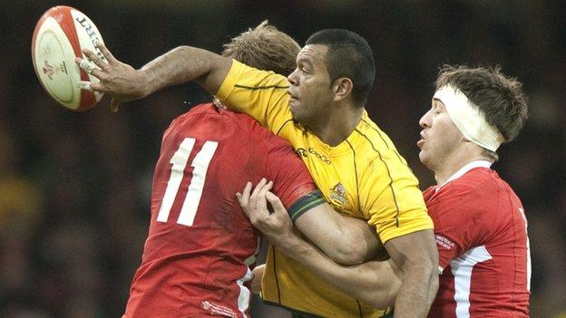 Australia's Kurtley Beale passes against Wales in November, 2012