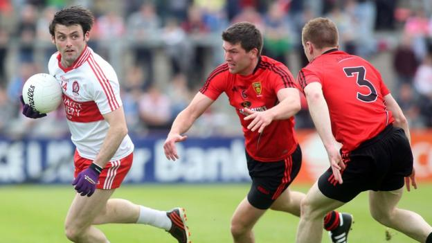 Derry forward Eoin Bradley moves clear of Peter Turley and Brendan McArdle