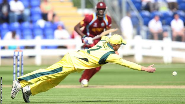 Australia's George Bailey is at full stretch as he attempts to catch out Jason Holder of the West Indies in their ICC Champions Trophy warm-up match in Cardiff. Australia won by four wickets