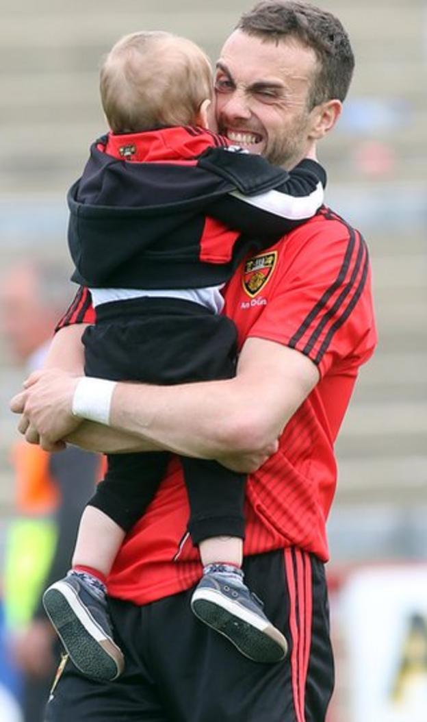 Down forward Conor Laverty gets a hug from his son Setanta after the Mourne men defeated Derry 2-17 to 1-15