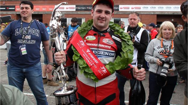The celebrations begin for Honda Fireblade rider Michael Dunlop after his victory in the six-lap Superbike event