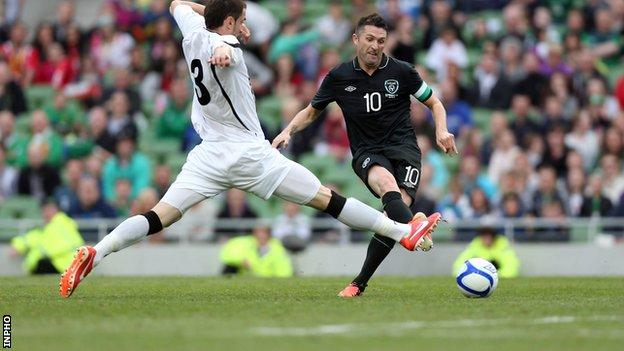 Robbie Keane scores his second goal in the match against Georgia