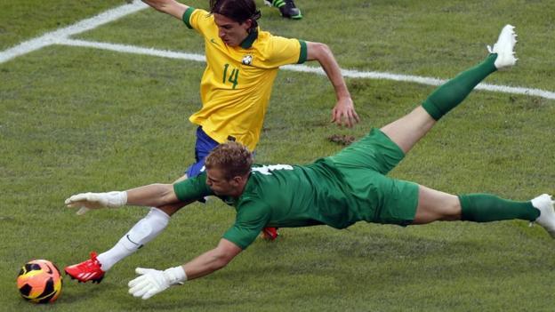 Joe Hart saves from Filipe Luis