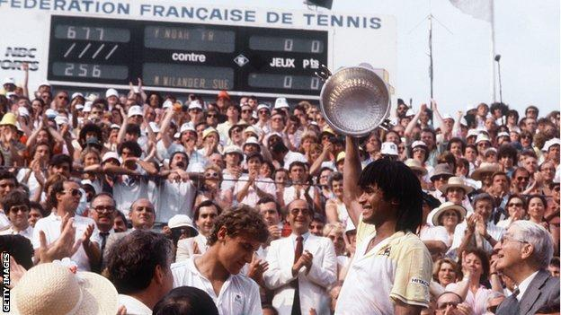 Yannick Noah lifts the French Open trophy
