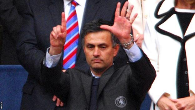 Jose Mourinho gesturing 'six' to supporters