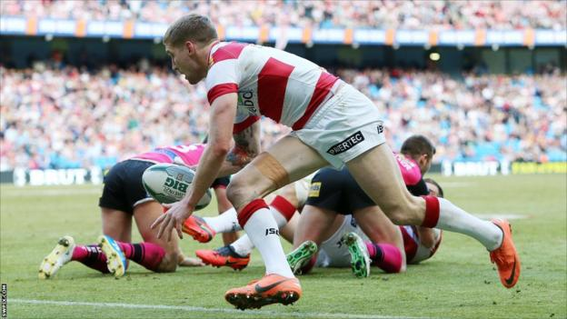 Sam Tomkins darts in for a try for Wigan against Leeds